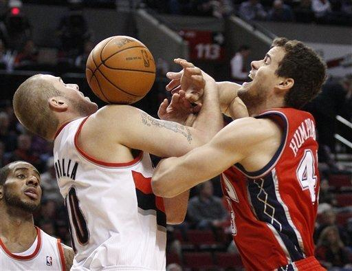 Portland Trail Blazers' Joel Przybilla (10) and New Jersey Nets' Kris Humphries (43) battle for a loose ball as Trail Blazers' LaMarcus Aldridge, left, watches during the first quarter of an NBA basketball game, Wednesday, April 4, 2012, in Portland, Ore. (AP Photo/Rick Bowmer)