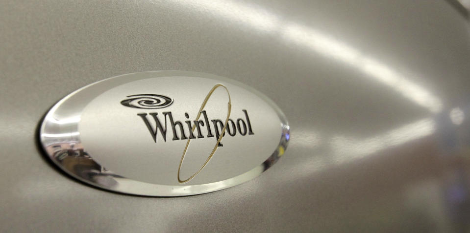 FILE - In this July 20, 2009 file photo, the Whirlpool logo appears on the face of a refrigerator for sale at the Sears Grand store in Solon, Ohio. Whirlpool said Friday, Aug. 28, 2009, it will cut 1,100 jobs and close a refrigerator factory in Evansville, Ind. (AP Photo/Amy Sancetta, file)