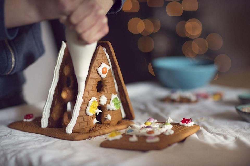 <p>Buy a gingerbread house kit and go to town with colorful designs and plenty of icing—there's no such thing as too much.</p>