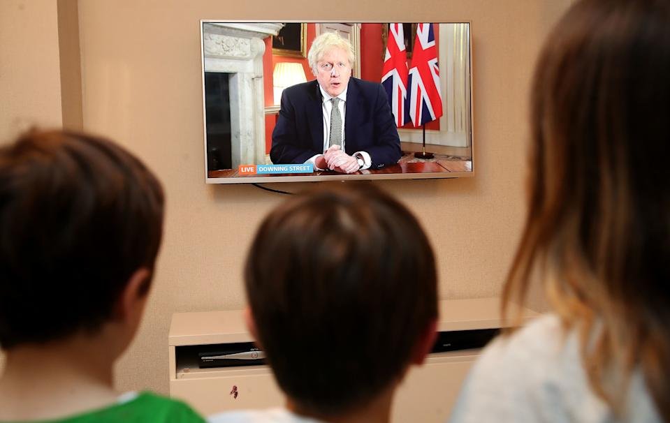 A family in Knutsford, Cheshire, watch Prime Minister Boris Johnson making a televised address to the nation from 10 Downing Street, London, setting out new emergency measures to control the spread of coronavirus in England.