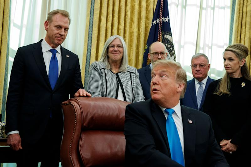 "Acting Secretary of Defense Patrick Shanahan listens as President Donald Trump speaks during a signing event for ""Space Policy Directive 4"" in the Oval Office of the White House on Feb. 19, 2019, in Washington. (Photo: Evan Vucci/AP)"