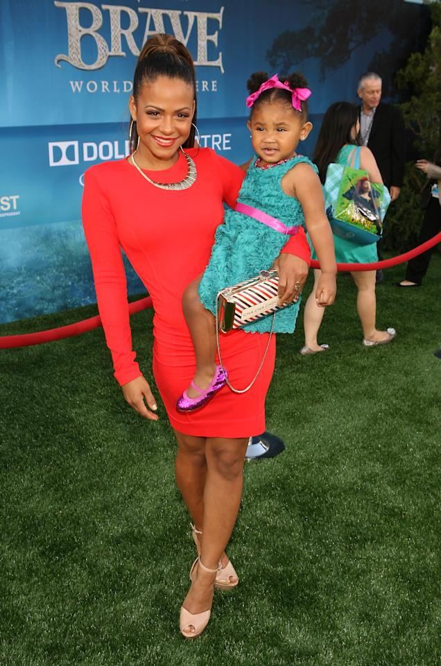 HOLLYWOOD, CA - JUNE 18:  Actress Christina Milian (L) arrives at Film Independent's 2012 Los Angeles Film Festival Premiere of Disney Pixar's 'Brave' at Dolby Theatre on June 18, 2012 in Hollywood, California.  (Photo by Jesse Grant/Getty Images)