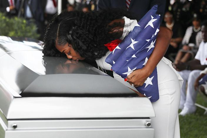 <p>OCT. 21, 2017 – Myeshia Johnson kisses the casket of her husband U.S. Army Sgt. La David Johnson during his burial service at the Memorial Gardens East cemetery in Hollywood, Florida. Sgt. Johnson and three other American soldiers were killed in an ambush in Niger on Oct. 4. (Photo: Joe Raedle/Getty Images) </p>