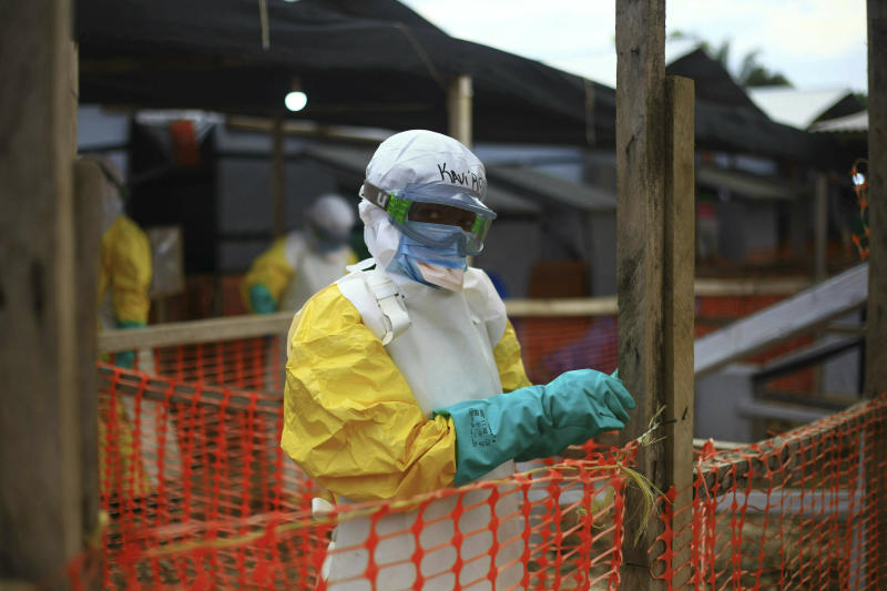 FILE - In this Tuesday April, 16, 2019 file photo, an Ebola health worker is seen at a treatment center in Beni, Eastern Congo. The World Health Organization spent nearly $192 million on travel expenses last year, with staffers sometimes breaking the agency's own rules by traveling in business class, booking expensive last-minute tickets and traveling without the required approvals, according to documents recently published by WHO on its website . (AP Photo/Al-hadji Kudra Maliro, file)
