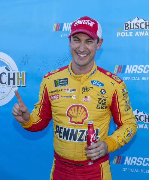 Joey Logano reacts after winning the pole position for a NASCAR Cup Series auto race at Martinsville Speedway in Martinsville, Va., Saturday, March 23, 2019. (AP Photo/Matt Bell)