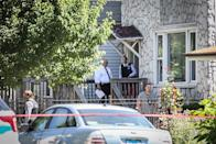 Police investigate outside the scene of a shooting outside a home in Chicago, Tuesday, June 15, 2021. Police say an argument at a house on Chicago's South Side erupted in fatal gunfire, leaving some dead and others injured.
