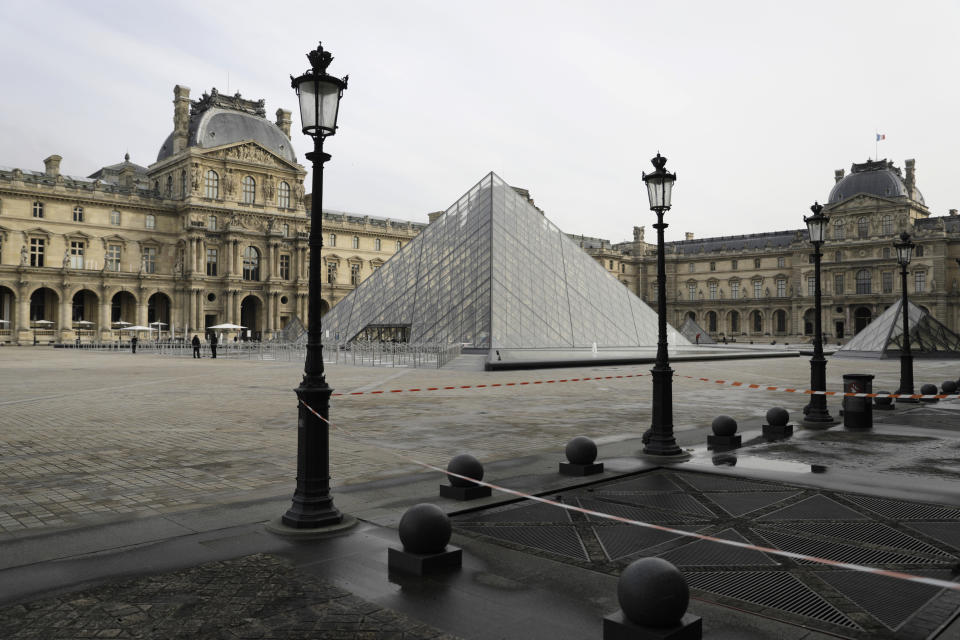 The almost empty courtyard of the Louvre museum is pictured Wednesday, Oct.14, 2020 in Paris. French President Emmanuel Macron is giving a nationally televised interview Wednesday night to speak about the virus, his first in months. French media reports say Macron will also step up efforts on social media to press the need for virus protections among young people. (AP Photo/Lewis Joly)