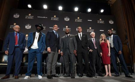 Feb 2, 2019; Atlanta, GA, USA; The Pro Football Hall of Fame Class of 2019 inductees Johnny Robinson and Ed Reed and Kevin Mawae and Ty Law and Tony Gonzalez and Gil Brandt and Brittany Bowlen (representing father Pat Bowlen) and Champ Bailey during media availabilities for the NFL Honors show at the Fox Theatre. Mandatory Credit: Kirby Lee-USA TODAY Sports