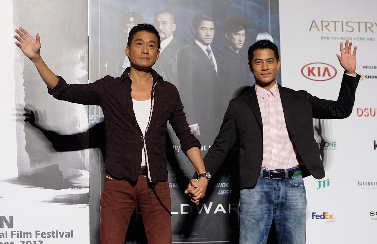"BUSAN, SOUTH KOREA - OCTOBER 04:  Actor Tony Leung Ka-Fai and Aaron Kwok attend at the opening film ""Cold War"" press conference during the 17th Busan International Film Festival (BIFF) at the Busan Cinema Center on October 4, 2012 in Busan, South Korea. The biggest film festival in Asia showcases 304 films from 75 countries and runs from October 4-13.  (Photo by Chung Sung-Jun/Getty Images)"