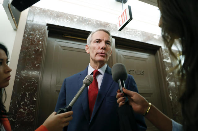 Sen. Rob Portman answers questions from the media as he returns to a hearing on Capitol Hill in September. (Photo: Pablo Martinez Monsivais/AP)