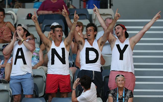 Supporters of Andy Murray of Britain cheer during his first round match against Go Soeda of Japan at the Australian Open tennis championship in Melbourne, Australia, Tuesday, Jan. 14, 2014.(AP Photo/Rick Rycroft)