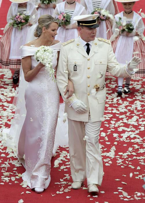 9. Prince Albert II And Charlene Wittstock : Princess Charlene of Monaco and Prince Albert II of Monaco leave the religious ceremony of the Royal Wedding of Prince Albert II of Monaco to Princess Charlene of Monaco in the main courtyard at the Prince's Palace on July 2, 2011 in Monaco.