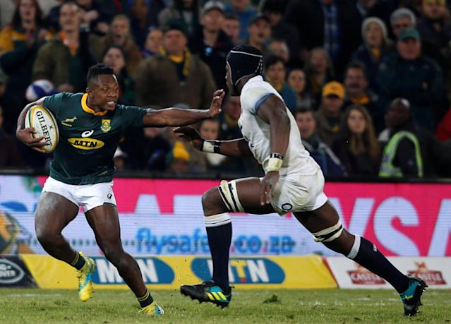 Rugby Union - Second Test International - South Africa v England - Free State Stadium, Bloemfontein, South Africa - June 16, 2018. South Africa's Sbusiso Nkosi is challenged by England's Maro Itoje. REUTERS/Siphiwe Sibeko