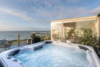 """<p>If it's sea views you're after, this Airbnb in Brighton can't be beaten. The penthouse on the historic Regency seafront is a stylish spot for a staycation, with its floor-to-ceiling windows, king-sized bed, waterfall shower and robes. The highlight has to be the terrace with a hot tub, where you can sip bubbles while taking the spectacular view.</p><p><strong>Sleeps:</strong> Two</p><p><strong>Price per night:</strong> £325.00</p><p><strong>Why we like it: </strong>A hot tub with views - what's not to like?</p><p><a class=""""link rapid-noclick-resp"""" href=""""https://airbnb.pvxt.net/n11QkX"""" rel=""""nofollow noopener"""" target=""""_blank"""" data-ylk=""""slk:SEE INSIDE"""">SEE INSIDE</a></p>"""