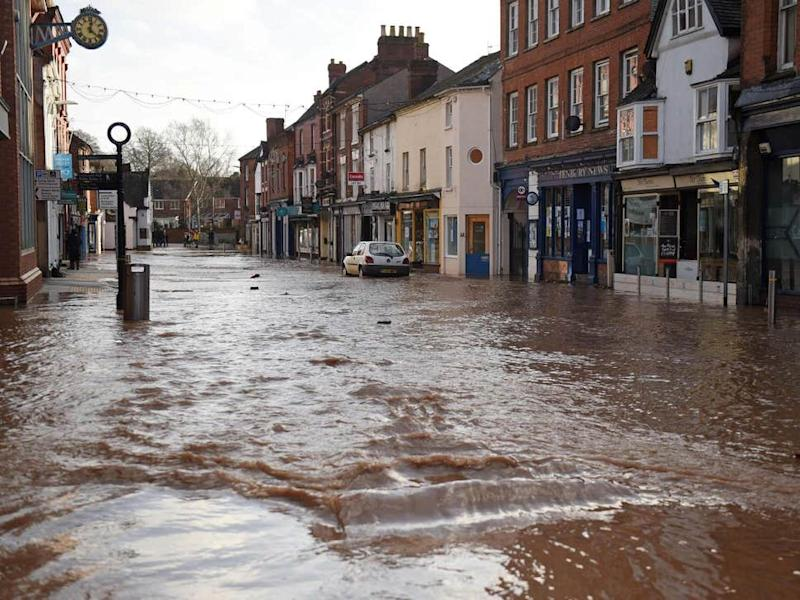Teme Street in Tenbury Wells, a market town in Worcestershire, is seen under floodwater from the overflowing River Teme amid Storm Dennis ( AFP via Getty Images )