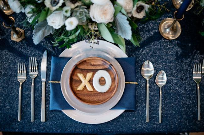 """<p>As you wait for the clock to strike twelve, surround your guests with midnight blue hues, such as in this New Year's Eve party from <a rel=""""nofollow noopener"""" href=""""https://greenweddingshoes.com/sparkly-modern-new-years-eve-wedding-inspiration/"""" target=""""_blank"""" data-ylk=""""slk:Green Wedding Shoes"""" class=""""link rapid-noclick-resp"""">Green Wedding Shoes</a>, for sophisticated yet seductive allure. </p>"""