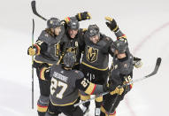 Vegas Golden Knights celebrate a goal during the third period of an NHL hockey playoff game against the Dallas Stars Monday, Aug. 3, 2020 in Edmonton, Alberta. (Jason Franson/The Canadian Press via AP)