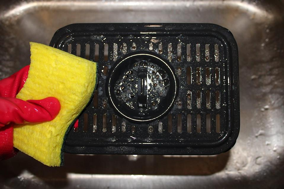 <p>After you wash the basket, wash the crisper plate with soap and water. If there's food stuck in the grates of your crisper plate that just won't budge, you can use a toothpick or wooden skewer to nudge it out.</p>