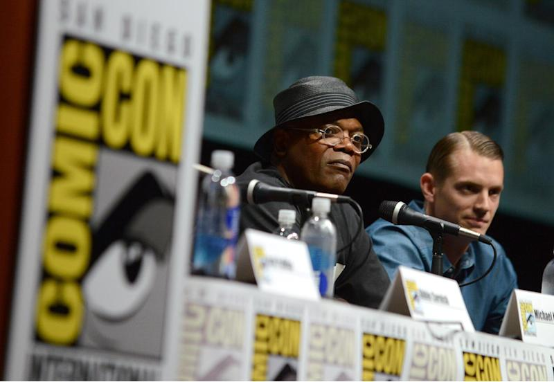 "Samuel L. Jackson, left, and Joel Kinnaman attend the ""RoboCop"" panel on Day 3 of Comic-Con International on Friday, July 19, 2103 in San Diego. (Photo by Jordan Strauss/Invision/AP)"