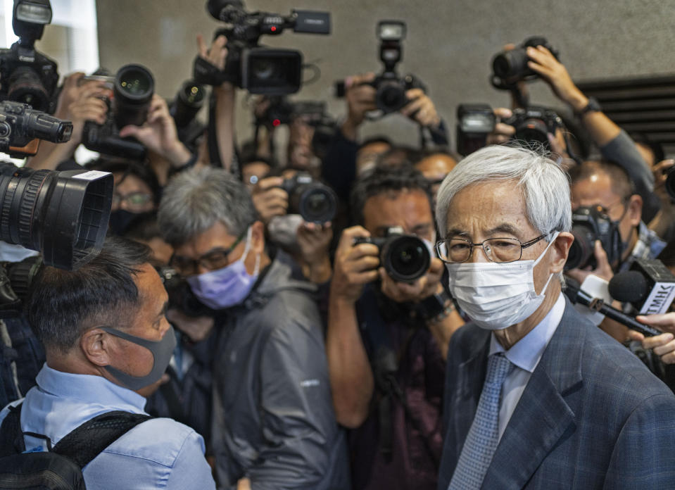Martin Lee, 82-year-old lawyer and former lawmaker, right, leaves a court after receiving a suspended sentence in Hong Kong Friday, April 16, 2021. A Hong Kong court on Friday sentenced five leading pro-democracy advocates, including media tycoon Jimmy Lai, to up to 18 months in prison for organizing a march during the 2019 anti-government protests that triggered an overwhelming crackdown from Beijing. (AP Photo/Vincent Yu)