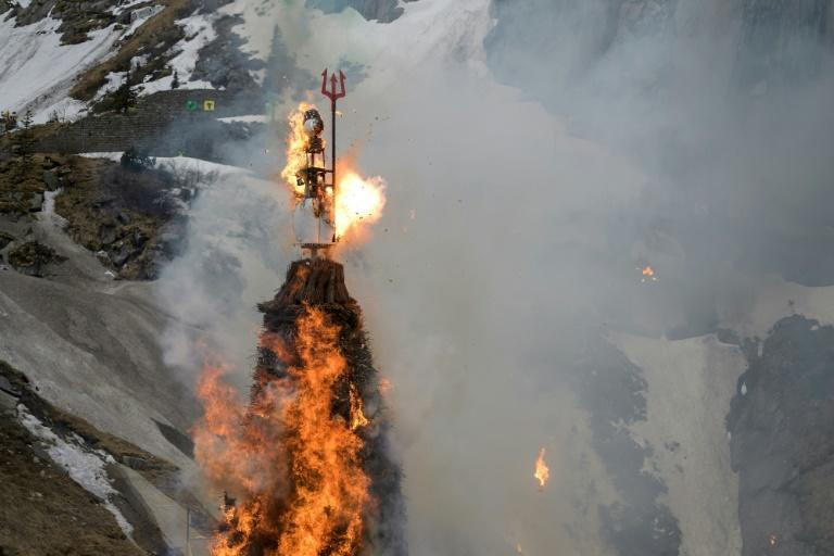 The snowman Boeoegg burns on a mountain pass in Switzerland as party of Zurich spring festival