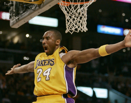 Los Angeles Lakers' Kobe Bryant celebrates a basket against the Phoenix Suns during the first half of their Western Conference playoff basketball game in Los Angeles, Thursday, April 26, 2007. (AP Photo/Chris Carlson)