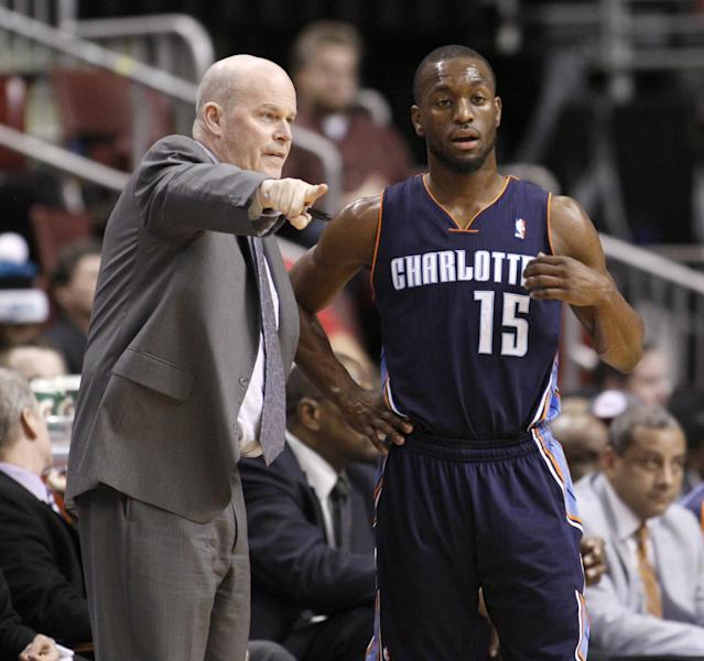 Charlotte Bobcats coach Steve Clifford talks to Kemba Walker (15) as they play against the Philadelphia 76ers' in the first half of an NBA basketball game, Wednesday, Jan. 15, 2014 in Philadelphia. (AP Photo/H. Rumph Jr.)