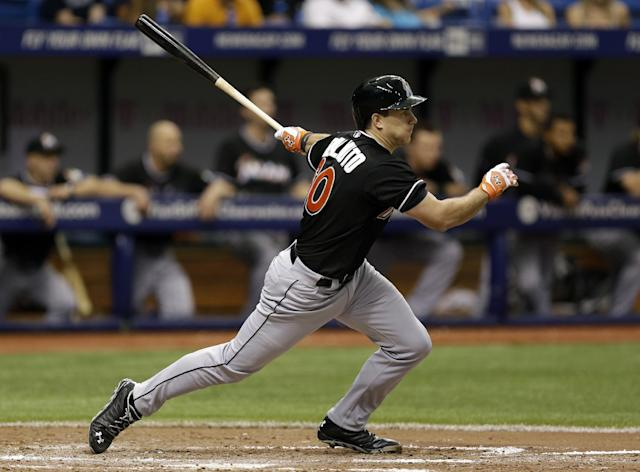 Miami Marlins' Jacob Realmuto follows through on a sixth inning RBI single off Tampa Bay Rays relief pitcher Jake McGee during an interleague baseball game Thursday, June 5, 2014, in St. Petersburg, Fla. Marlins' Garrett Jones scored on the hit. (AP Photo/Chris O'Meara)