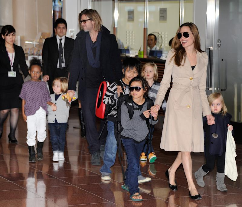 Angelina Jolie and Brad Pitt with their six kids Maddox, Pax, Zahara, Shiloh, Knox, and Vivienne in 2011