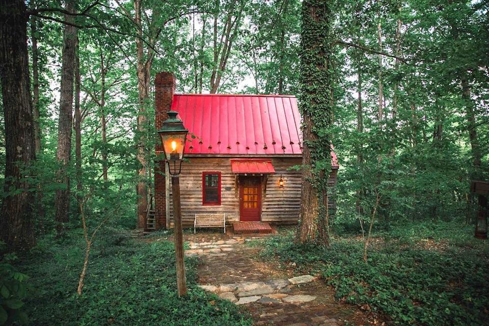 """If you're looking for a secluded fall escape, this petite one-bedroom cabin set on 50 acres should be a no-brainer. Originally built in the 1800s—and moved to its current location about 15 minutes from the town of Appomattox, Virginia, and four hours south of <a href=""""https://www.cntraveler.com/destinations/washington-dc?mbid=synd_yahoo_rss"""" rel=""""nofollow noopener"""" target=""""_blank"""" data-ylk=""""slk:Washington, D.C."""" class=""""link rapid-noclick-resp"""">Washington, D.C.</a>, in the '70s—the cabin offers expected creature comforts like Wi-Fi, a well-equipped kitchen, and modern bathrooms. There's also an outdoor patio with views of the trees, and access to 900 feet of private riverfront along the chilly Appomattox River (complete with its own waterside fire pit). $236, Airbnb (Starting Price). <a href=""""https://www.airbnb.com/rooms/43466214"""" rel=""""nofollow noopener"""" target=""""_blank"""" data-ylk=""""slk:Get it now!"""" class=""""link rapid-noclick-resp"""">Get it now!</a>"""