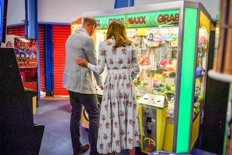 The Duke and Duchess of Cambridge play a grab a teddy game at Island Leisure Amusement Arcade, where Gavin and Stacey was filmed, during their visit to Barry Island, South Wales, to speak to local business owners about the impact of COVID-19 on the tourism sector.