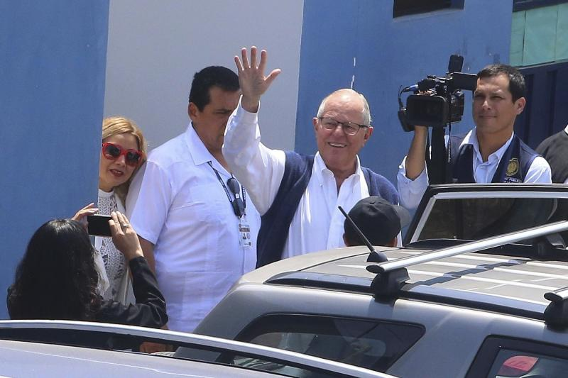In this photo provided by the Andina News Agency, Peru's former President Pedro Pablo Kuczynski, waves as he leaves a medical branch of the prosecutor's office, in Lima, Peru, Wednesday, April 10, 2019. A judge in Peru has ordered the detention for 10 days of the former leader as part of a money laundering probe into his consulting work for Brazilian construction giant Odebrecht, at the heart of Latin America's biggest graft scandal. (Vidal Tarqui/Andina News Agency via AP)