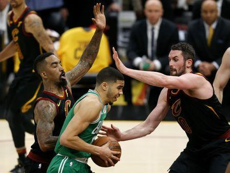 May 19, 2018; Cleveland, OH, USA; Cleveland Cavaliers center Kevin Love (0) defends Boston Celtics forward Jayson Tatum (0) during the third quarter in game three of the Eastern conference finals of the 2018 NBA Playoffs at Quicken Loans Arena. Mandatory Credit: Aaron Doster-USA TODAY Sports