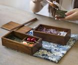 """And here's a much more traditional-looking double layer bento, handcrafted in camphor wood and sure to make you excited for lunch hour to roll around. $38, Etsy. <a href=""""https://www.etsy.com/listing/873318128/double-layer-wooden-lunch-box-wood"""" rel=""""nofollow noopener"""" target=""""_blank"""" data-ylk=""""slk:Get it now!"""" class=""""link rapid-noclick-resp"""">Get it now!</a>"""