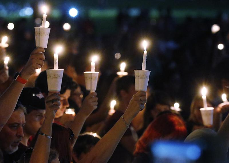 Candles at one of the vigils honouring the victims at Stoneman High: AP