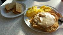 """<p><a href=""""https://www.yelp.com/biz/pennys-diner-cheyenne"""" rel=""""nofollow noopener"""" target=""""_blank"""" data-ylk=""""slk:Penny's Diner"""" class=""""link rapid-noclick-resp"""">Penny's Diner</a> in Cheyenne</p><p>Check out the blue plate specials at this 50s-style joint, and if nothing tickles your fancy, you can't go wrong with the ranch breakfast — chicken fried steak with white gravy, hash browns, eggs and toast.</p>"""