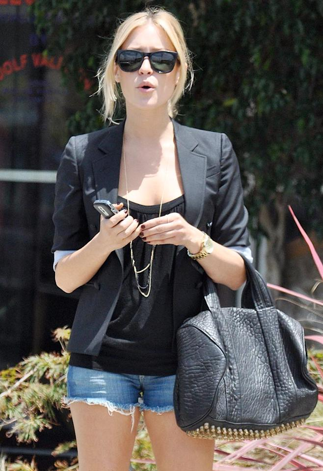 """Audrina isn't the only """"Hills"""" hottie obsessed with a particular purse. Her onscreen and off-screen arch nemesis, Kristin Cavallari, is seldom seen without her favorite bag, the coveted Alexander Wang studded """"Coco"""" duffel. <a href=""""http://www.x17online.com"""" target=""""new"""">X17 Online</a> - July 13, 2009"""