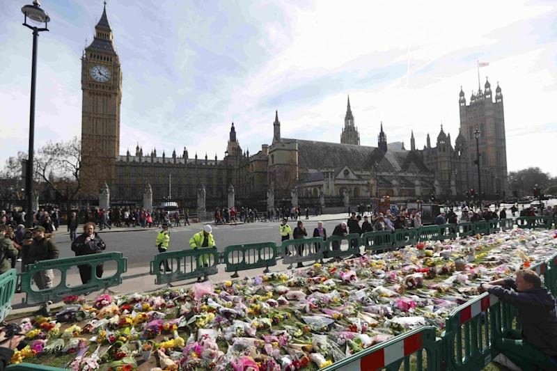 Floral tributes outside Parliament (REUTERS)