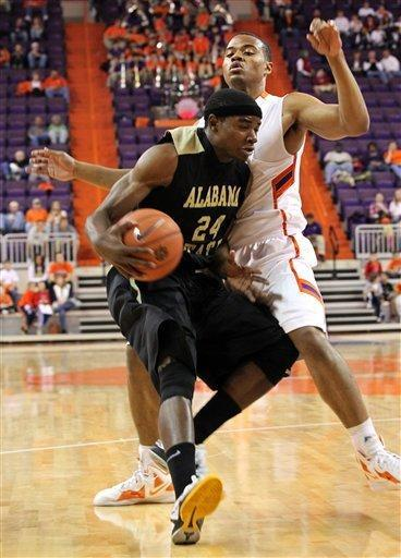 Alabama State's Stephawn Brown, left, gets fouled by Clemson's Bernard Sullivan as he drives to the basket in the first half of their NCAA college basketball game on Monday, Dec. 19, 2011, in Clemson, S.C. (AP Photo/Anderson Independent-Mail, Mark Crammer)