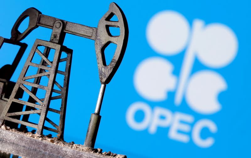 FILE PHOTO: A 3D-printed oil pump jack is seen in front of a displayed OPEC logo in this illustration picture