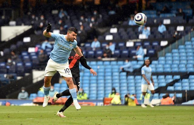 Sergio Aguero heads in his 260th Manchester City goal