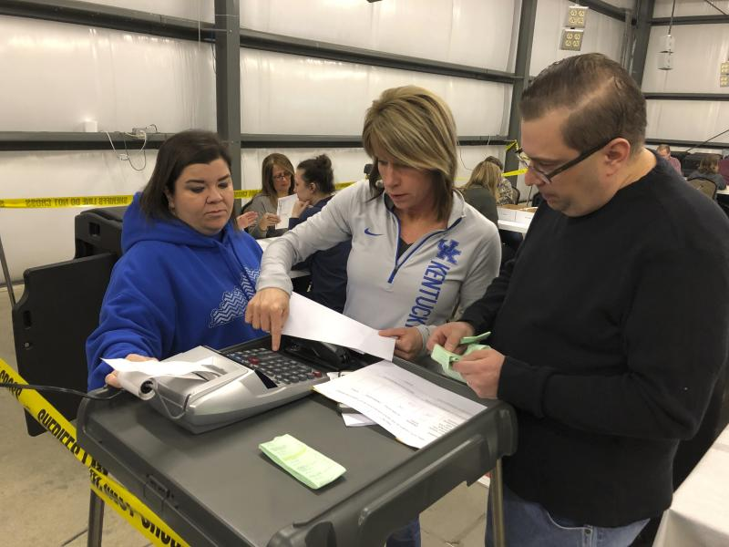 From right, Daviess County Chief Deputy Clerk Richard House and deputy clerks Tonya Payne and Kelli Shively review vote totals during a recount of Kentucky House district 13 on Saturday, Feb. 2, 2019, in Owensboro, Ky. Democrat Jim Glenn won the race by one vote in November. But the Republican-controlled legislature ordered a recount at the request of GOP candidate DJ Johnson. (AP Photo/Adam Beam)