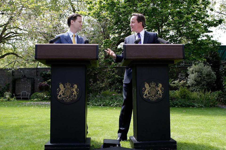 LONDON, ENGLAND - MAY 12:  Prime Minister David Cameron (R) and Deputy Prime Minister Nick Clegg hold their first joint press conference in the Downing Street garden on May 12, 2010 in London, England. On his first full day as Prime Minister, David Cameron has made a series of cabinet appointments including Nick Clegg as Deputy Prime Minister. The Conservatives and Liberal Democrats have now agreed to lead the country with a fully inclusive coalition government.  (Photo by Christopher Furlong - WPA Pool /Getty Images)