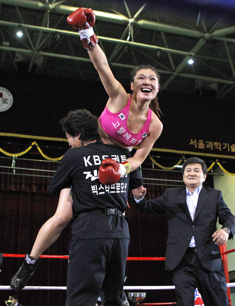 FILE - In this Dec. 17, 2011, file photo, South Korean champion Choi Hyunmi, a former North Korean defector, celebrates her victory over challenger Sainamdoy Pitaklongen of Thailand after their WBA women's featherweight title boxing bout in Seoul, South Korea. South Korea's only boxing world champion is Choi, a North Korean defector who fled her authoritarian homeland as a 13-year-old girl with her family in 2003. (AP Photo/ Lee Jin-man, File)