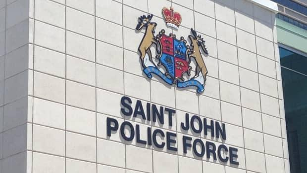 Saint John police say a motorcyclist was taken to Saint JohnRegional Hospital after being injured just before 7 p.m. on McDonald Street. (Matthew Bingley/CBC - image credit)