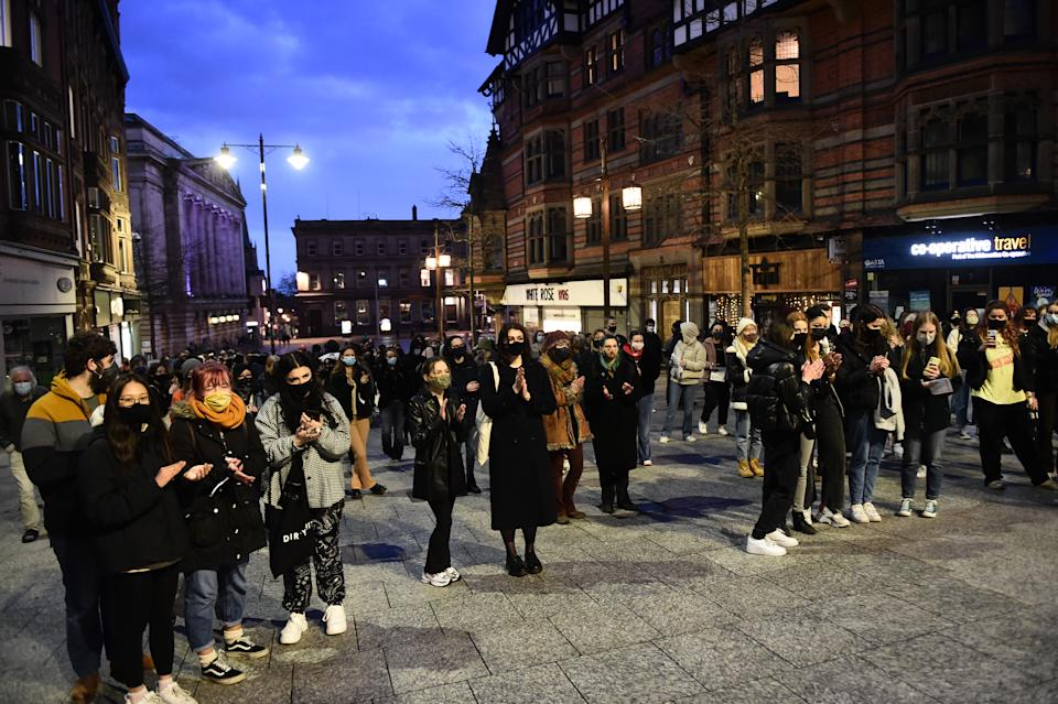 NOTTINGHAM, ENGLAND - MARCH 13: People attend during a vigil for Sarah Everard following her kidnap and murder on March 13, 2021 in Nottingham, England.  Vigils are being held across the United Kingdom in memory of Sarah Everard. Yesterday, the Police confirmed that the remains of Ms Everard were found in a woodland area in Ashford, a week after she went missing as she walked home from visiting a friend in Clapham. Metropolitan Police Officer Wayne Couzens has been charged with her kidnap and murder. (Photo by Nathan Stirk/Getty Images)