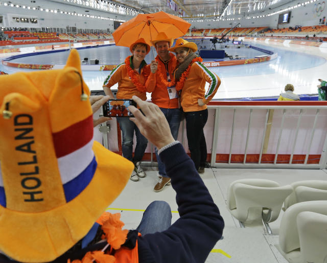 Dutch fans pose for photographs before the start of the men's 5000m speedskating race at the Adler Arena Skating Center at the 2014 Winter Olympics, Saturday, Feb. 8, 2014, in Sochi, Russia. (AP Photo/Patrick Semansky)