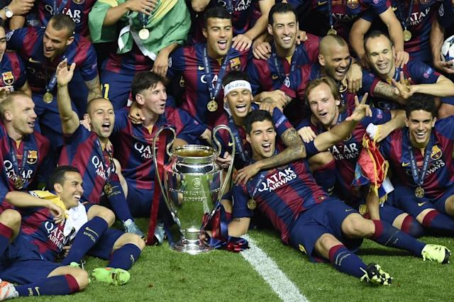 Barcelona FC players celebrate with the trophy after winning their UEFA Champions League Final match against Juventus, at the Olympic Stadium in Berlin, on June 6, 2015 (AFP Photo/Odd Andersen)