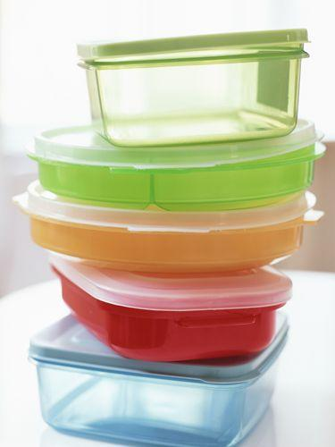 <p>Because plastic food containers are porous, they frequently retain odors even after washing. Store them with crumpled-up black-and-white newspaper inside to absorb odors. Then give containers a rinse before using again.</p>
