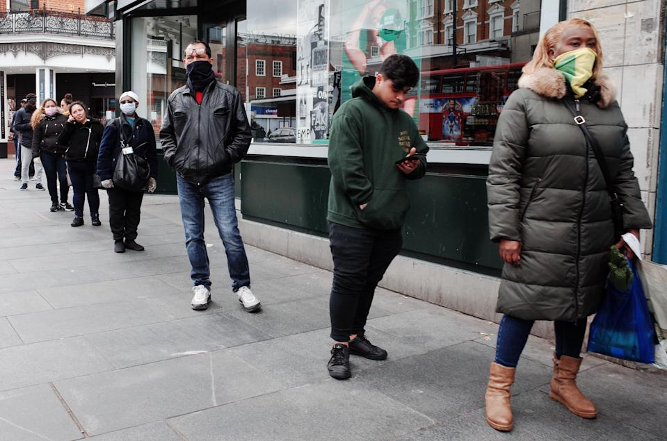 People wearing masks observe 'social distancing' guidelines while queueing to enter a supermarket on Brixton Road at Brixton in the borough of Lambeth in London, England, on April 1, 2020. Official figures report that Lambeth currently has 418 recorded cases of the covid-19 coronavirus, higher than any other local authority district in London and fourth among local authorities in England as a whole (behind Sheffield, Hampshire and Birmingham). The borough was previously trailing the neighbouring south London district of Southwark, which remains similarly hard-hit, currently with 415 cases. (Photo by David Cliff/NurPhoto via Getty Images)